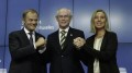European Council President Herman Van Rompuy, center, holds the hands of Polish Prime Minister Donald Tusk, left, and Italian Foreign Minister Federica Mogherini during a media conference at an EU summit in Brussels, Saturday, Aug. 30, 2014. European Union leaders have nominated Italy's Mogherini to become the 28-nation bloc's new foreign policy chief for the next five years. The EU leaders also elected Polish Prime Minister Donald Tusk to succeed European Council President Herman Van Rompuy in December as EU summit chairman and behind-the-scenes broker of compromises among national leaders. (AP Photo/Yves Logghe)