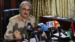 General Khalifa Haftar speaks during a news conference at Benina air base in Benghazi May 24, 2014. Haftar, a former Gaddafi ally who split with the autocrat in the 1980s, is the latest player to emerge in Libya's network of former fighters vying for control over parts of the country. REUTERS/Esam Omran Al-Fetori (LIBYA - Tags: POLITICS CIVIL UNREST) - RTR3QNS9